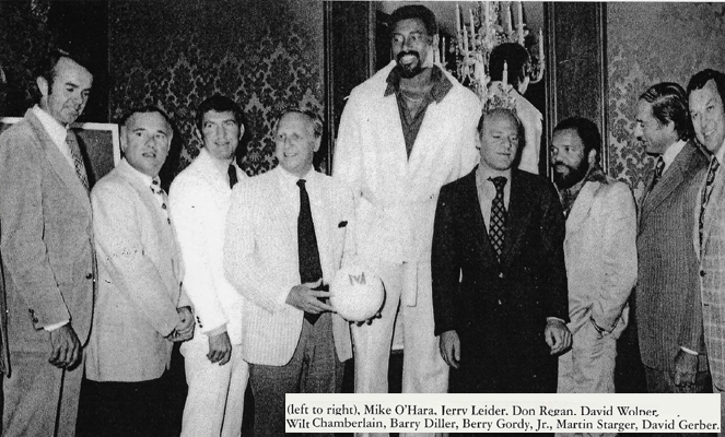 Wilt Chamberlain just looks tall in this picture because the other guys are so short.